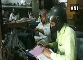 UP govt employees wear helmets while work in building with holes in roof