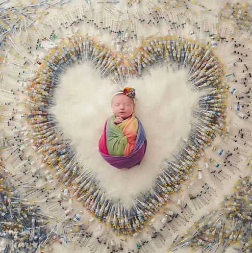 miracle baby,miracle baby photo-shoot,baby photo shoot with 1616 ivf needles around,weird story